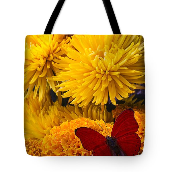 Red Butterfly On African Marigold Tote Bag by Garry Gay
