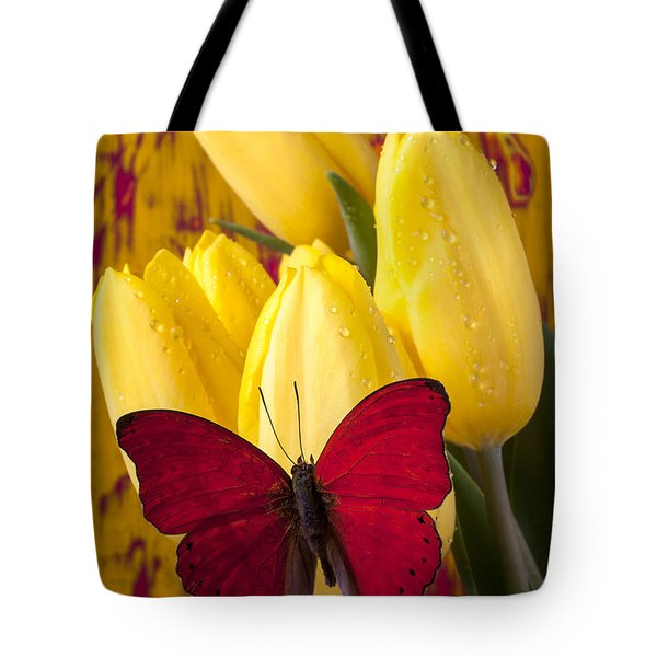 Red Butterfly Resting On Tulips Tote Bag by Garry Gay
