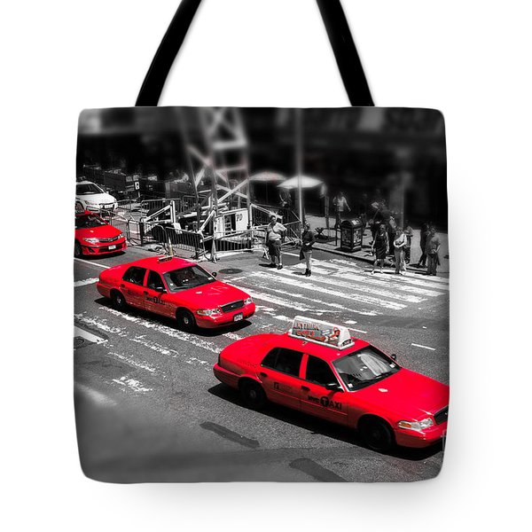 Red Cabs On Time Square Tote Bag by Hannes Cmarits