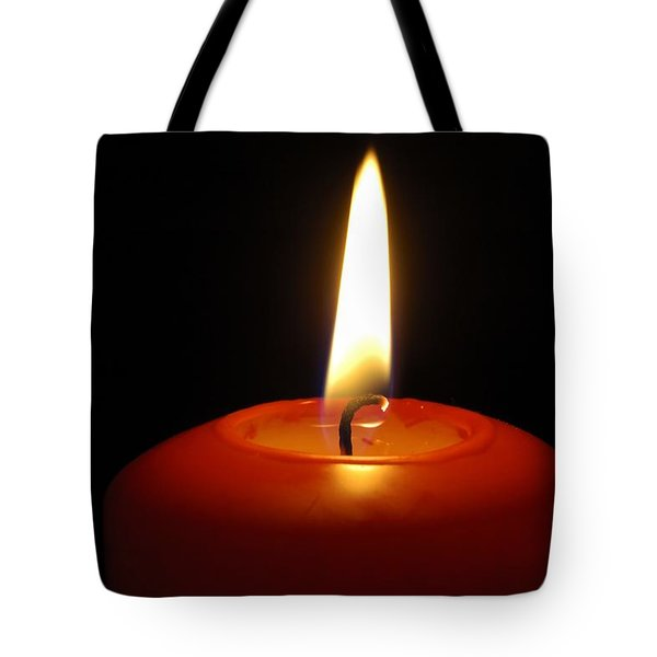 Red candle burning Tote Bag by Matthias Hauser
