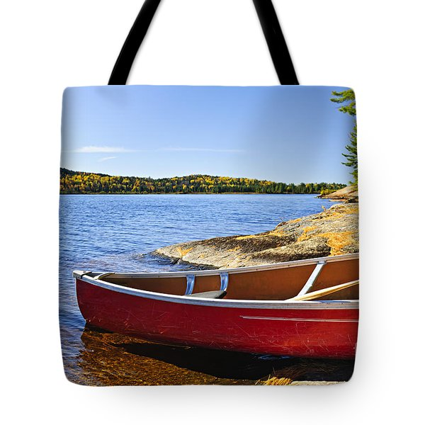 Red Canoe On Shore Tote Bag by Elena Elisseeva