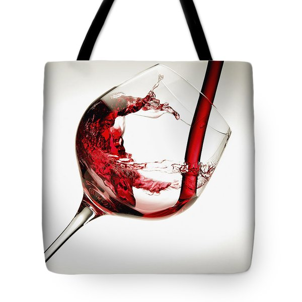 Red Wine Pouring Into A Glass Tote Bag by Richard Desmarais