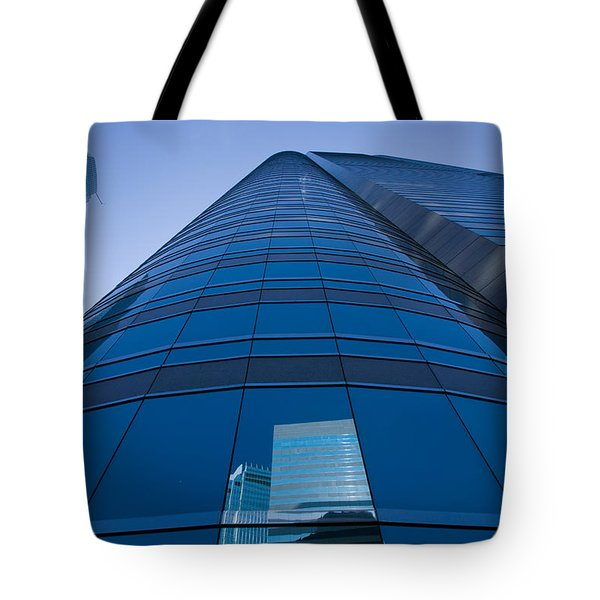 Reflection Of Buildings On A Stock Tote Bag by Panoramic Images