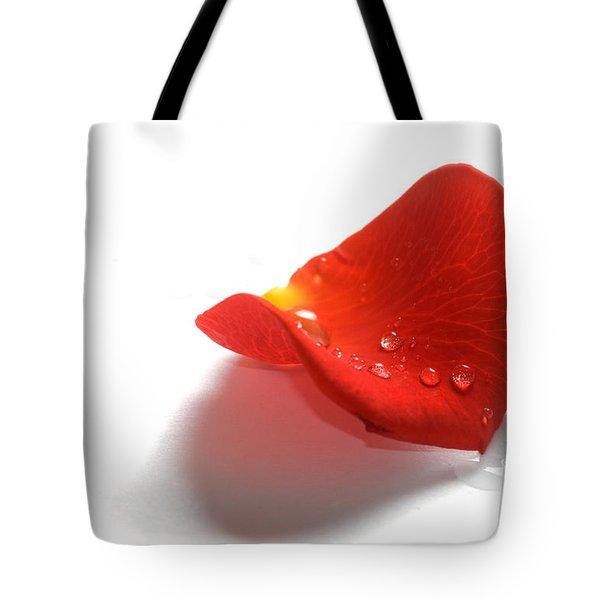 Rose Petal On White Background Tote Bag by Michal Bednarek