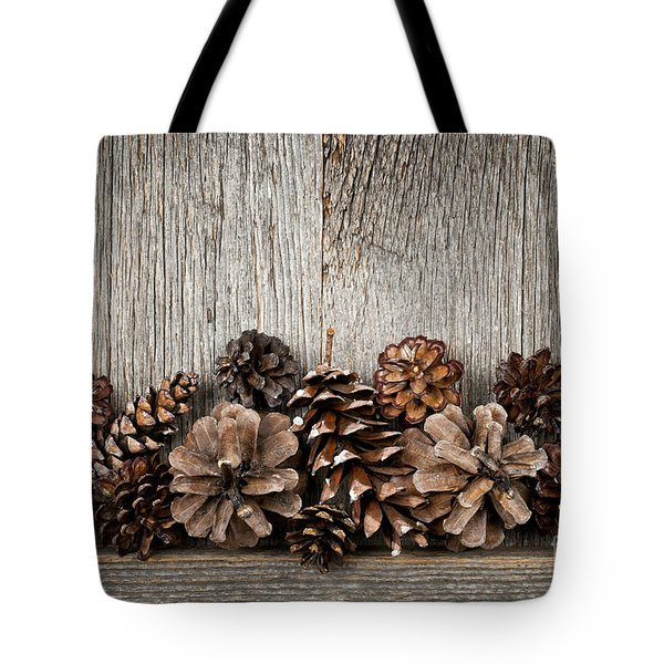Rustic wood with pine cones Tote Bag by Elena Elisseeva