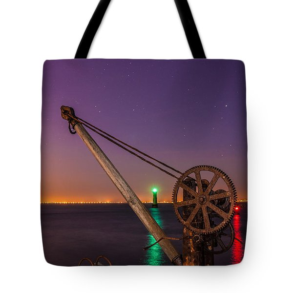 Rusty Davit And Two Lighthouses Tote Bag by Semmick Photo