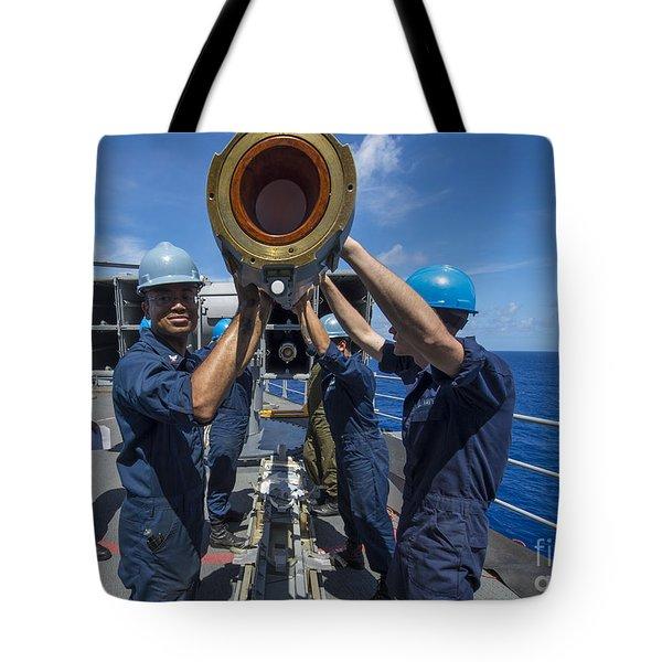 Sailors Load Rim-7 Sea Sparrow Missiles Tote Bag by Stocktrek Images