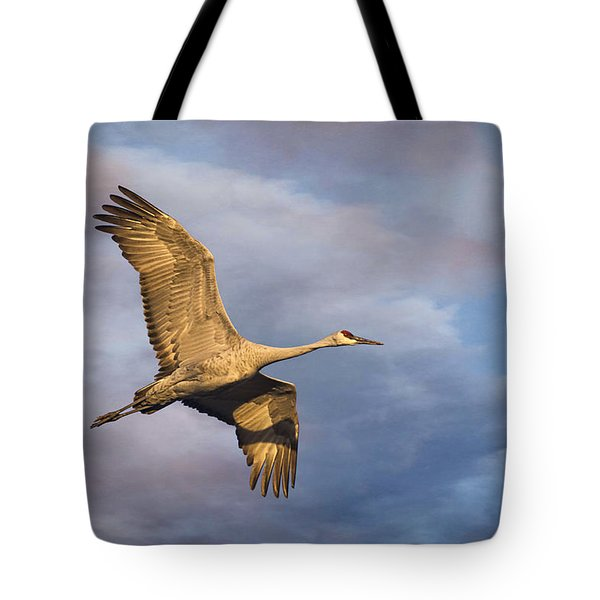 Sandhill Crane In Flight Tote Bag by Priscilla Burgers