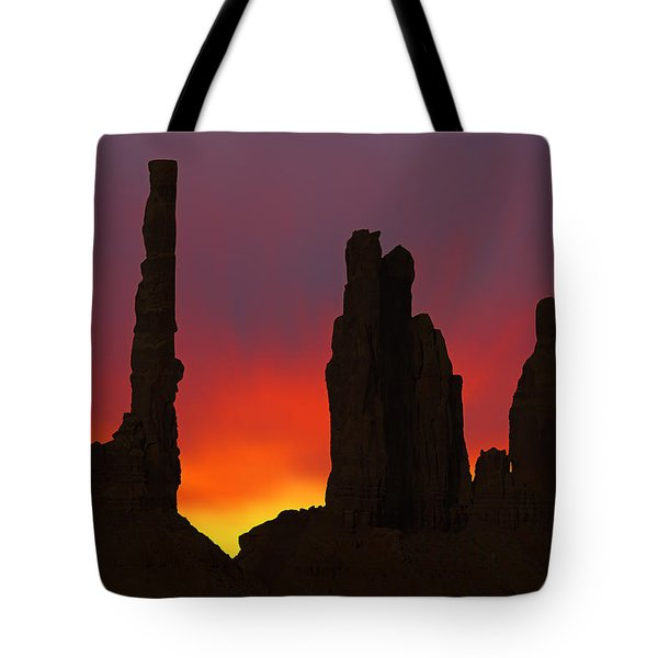 Silhouette Of Totem Pole After Sunset - Monument Valley Tote Bag by Mike McGlothlen