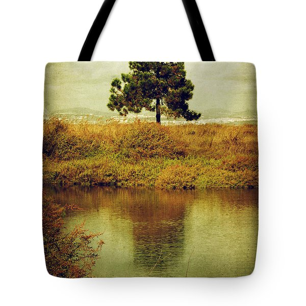 Single pine tree Tote Bag by Carlos Caetano