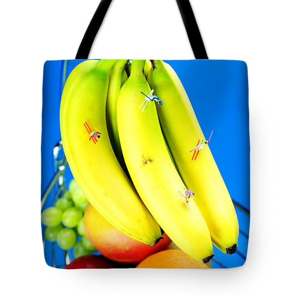 Skiing On Banana Little People On Food Tote Bag by Paul Ge