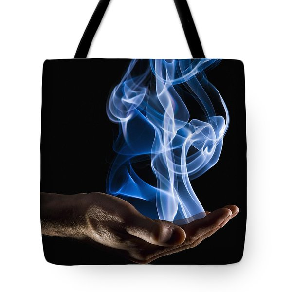 Smoke Wisps From A Hand Tote Bag by Corey Hochachka