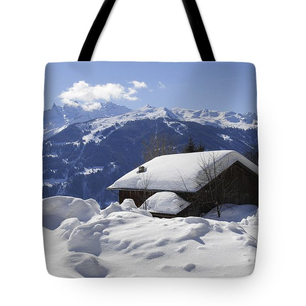 Snow-covered House In The Mountains In Winter Tote Bag by Matthias Hauser