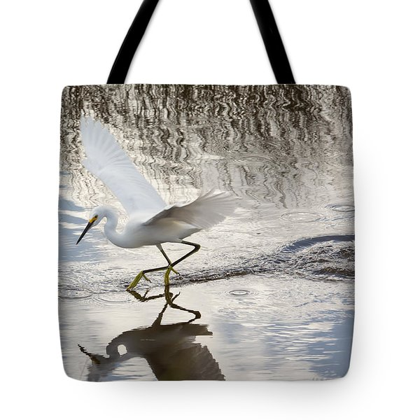 Snowy Egret Gliding Across the Water Tote Bag by John Bailey