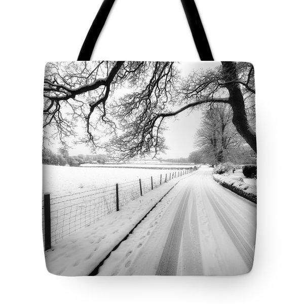 Snowy Lane Tote Bag by Adrian Evans