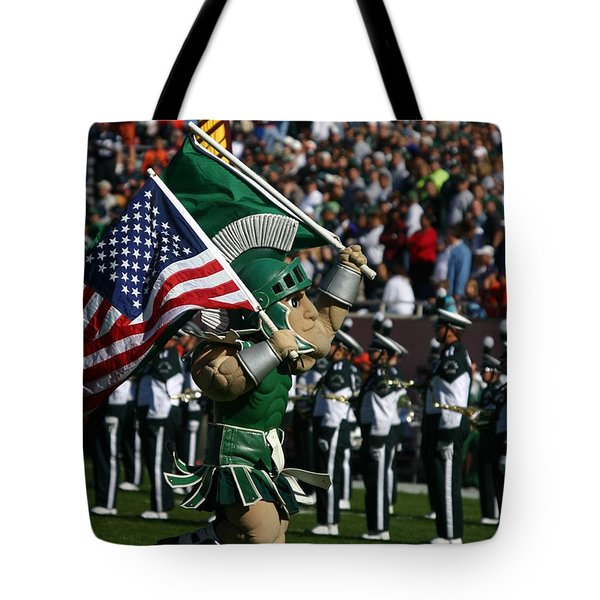 Sparty At Football Game Tote Bag by John McGraw