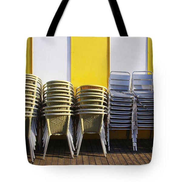 Stacks of Chairs and Tables Tote Bag by Carlos Caetano