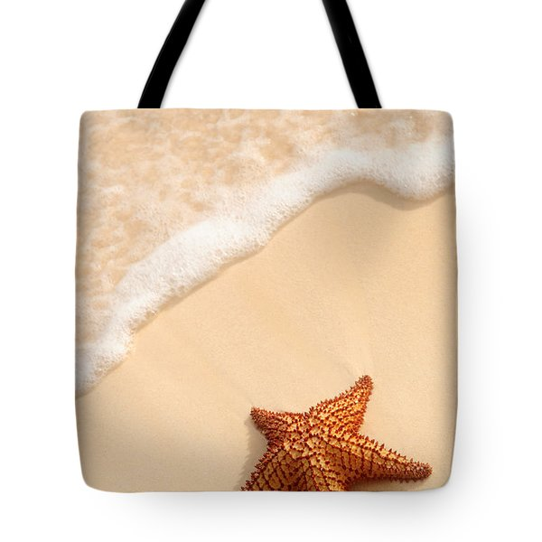 Starfish and ocean wave Tote Bag by Elena Elisseeva