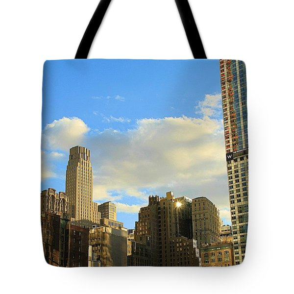 Manhattan Skyline Here Comes The Sun Tote Bag by Dan Sproul