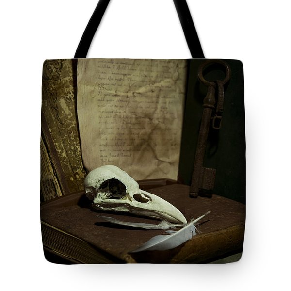still life with old books rusty key bird skull and feathers Tote Bag by Jaroslaw Blaminsky