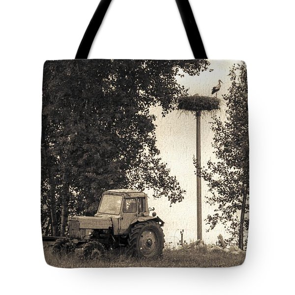 Stork Vs Tractor Tote Bag by Yevgeni Kacnelson