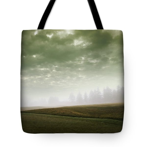 Storm Clouds And Foggy Hills Tote Bag by Vast Photography