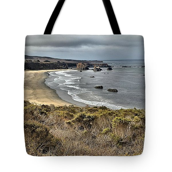 Storms Over An Unspoiled Beach Tote Bag by Adam Jewell