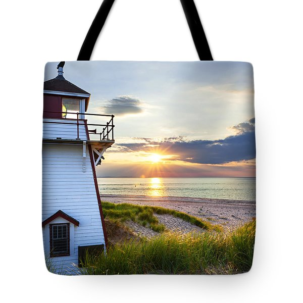 Sunset at Covehead Harbour Lighthouse Tote Bag by Elena Elisseeva