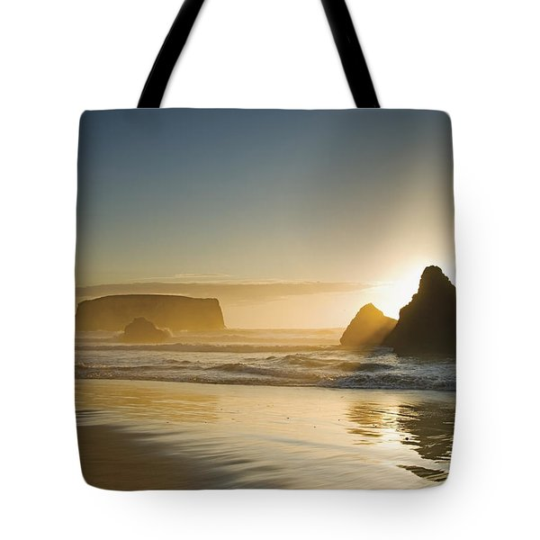 Sunset Behind Offshore Rocks Bandon Tote Bag by Philippe Widling