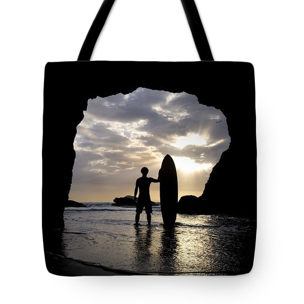 Surfer Inside A Cave At Muriwai New Tote Bag by Deddeda