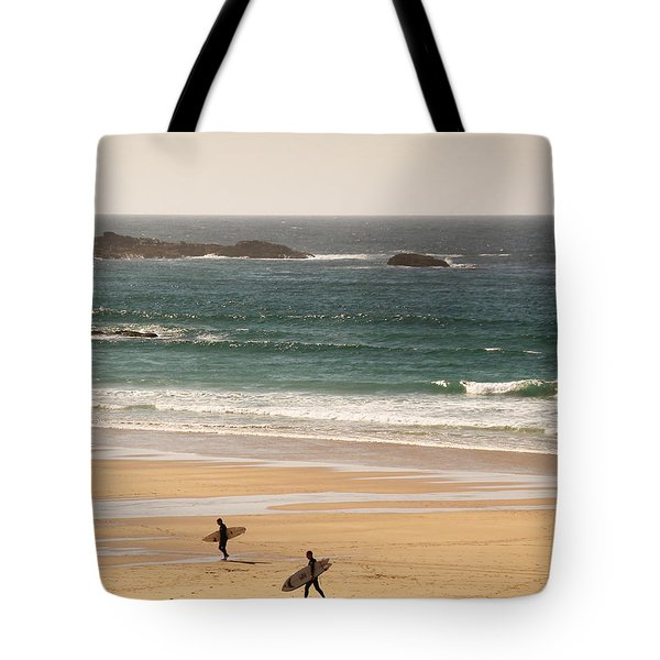 Surfers On Beach 01 Tote Bag by Pixel Chimp
