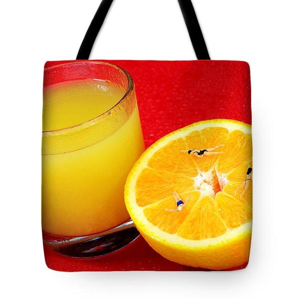 Swimming On Orange Little People On Food Tote Bag by Paul Ge