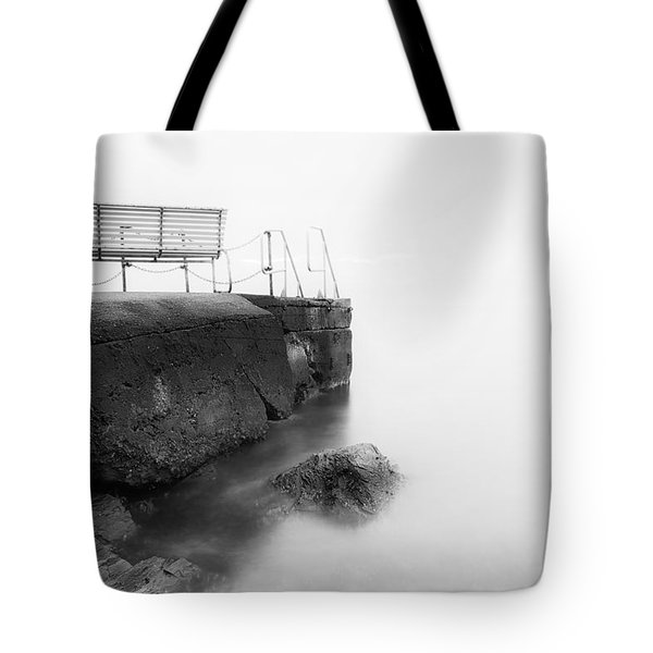 The Bench And The Fog Tote Bag by Erik Brede
