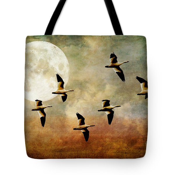 The Flight Of The Snow Geese Tote Bag by Lois Bryan