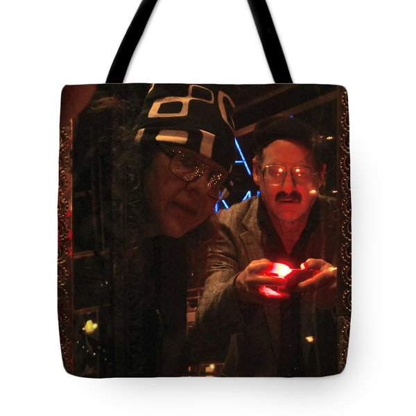 The Mirror Has A Glow Tote Bag by Kym Backland