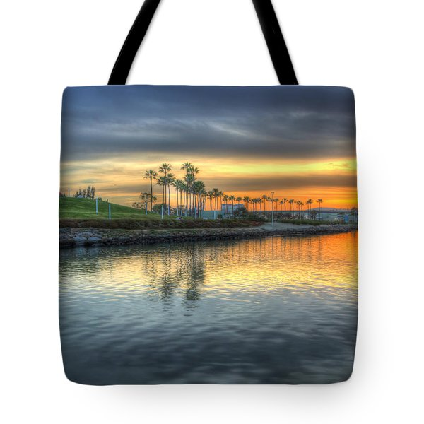 The Sinking Sun Tote Bag by Heidi Smith