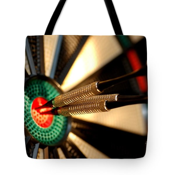 Three Arrows In The Centre Of A Dart Board Tote Bag by Michal Bednarek