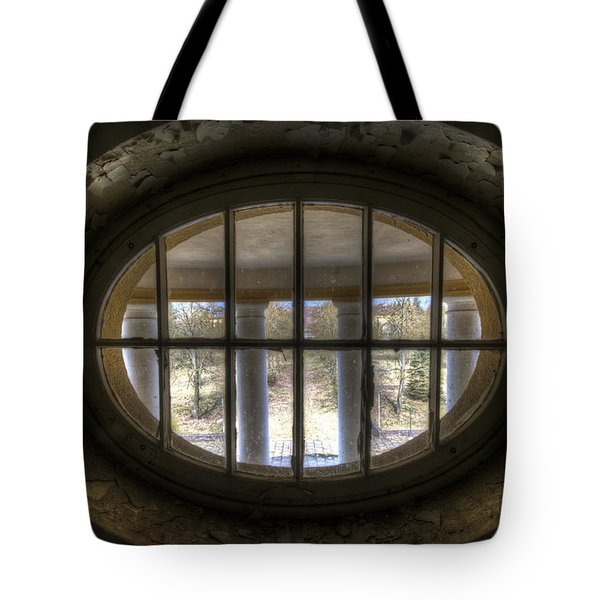 Through The Round Window Tote Bag by Nathan Wright