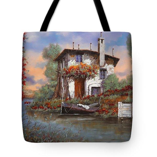 tramonto con bougainvillea Tote Bag by Guido Borelli