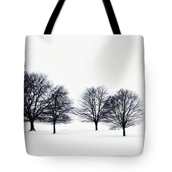 Trees In A Snowy Field In Chatsworth Tote Bag by John Doornkamp