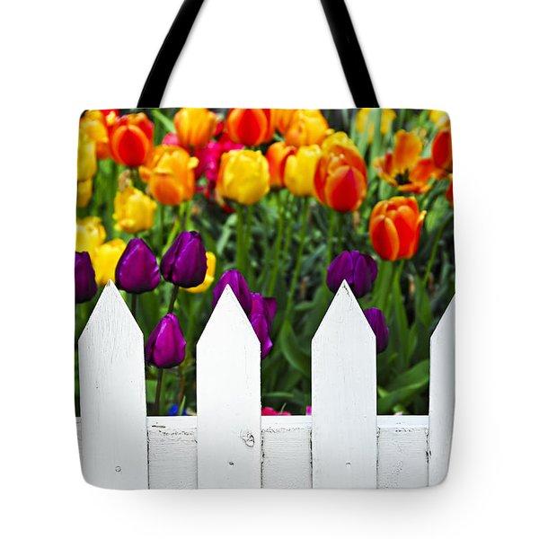 Tulips behind white fence Tote Bag by Elena Elisseeva