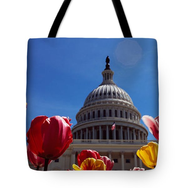 Tulips With A Government Building Tote Bag by Panoramic Images