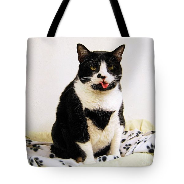 Tuxedo Cat sticking Out Her Tongue Tote Bag by Catherine Sherman