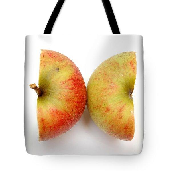 Two Apple Halves Tote Bag by Michal Bednarek