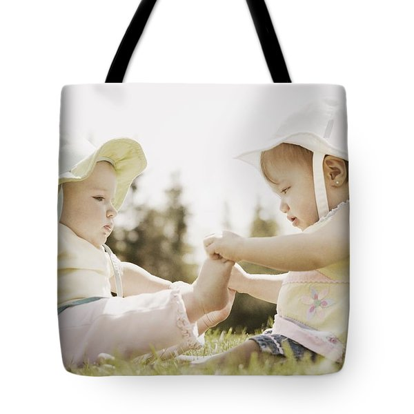 Two Girls Sit Together Tote Bag by Don Hammond