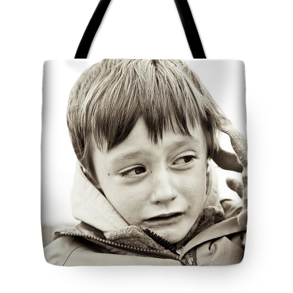 Unhappy boy Tote Bag by Tom Gowanlock