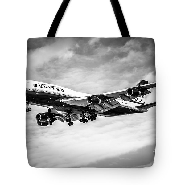 United Airlines Airplane In Black And White Tote Bag by Paul Velgos