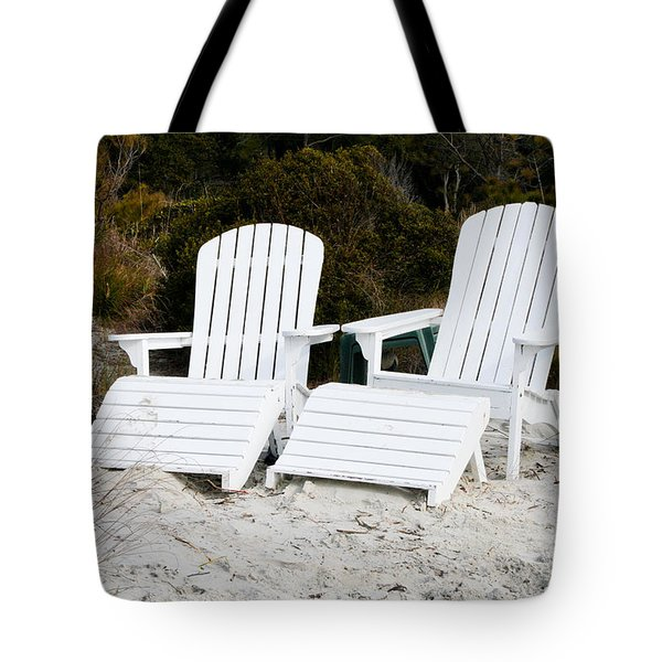 White Adirondack Chairs In The Sand Tote Bag by Thomas Marchessault