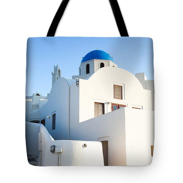 White buildings and blue church in Oia Santorini Greece Tote Bag by Matteo Colombo