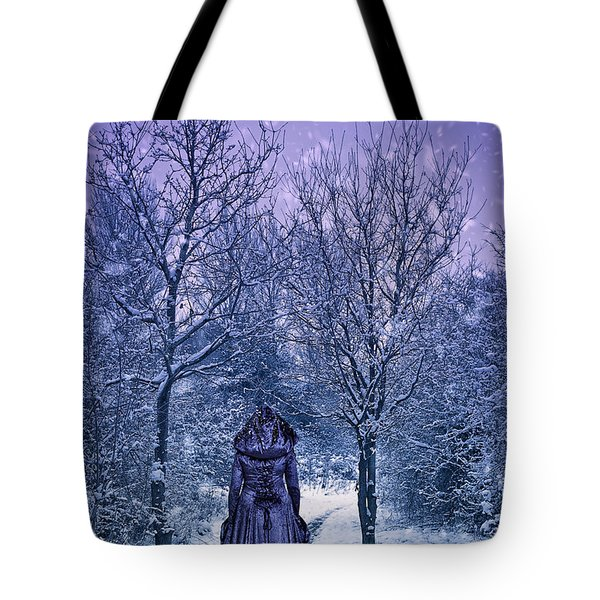 Woman Walking In Snow Tote Bag by Amanda And Christopher Elwell